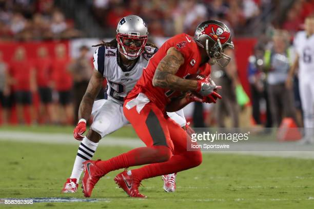 Tampa Bay Buccaneers wide receiver Mike Evans catches a pass infant of New England Patriots cornerback Stephon Gilmore during the NFL game between...