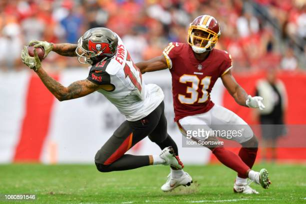 Tampa Bay Buccaneers wide receiver Mike Evans makes a catch while defended by Washington Redskins cornerback Fabian Moreau during the second half of...