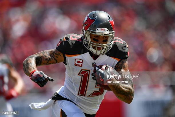 Tampa Bay Buccaneers wide receiver Mike Evans runs toward the sideline to stop the clock during an NFL football game between the Chicago Bears and...