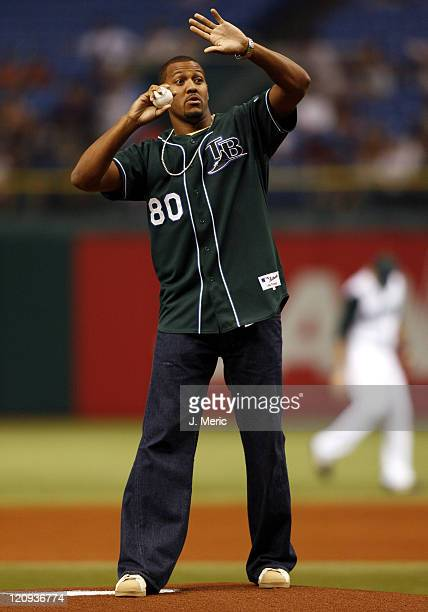 Tampa Bay Buccaneers wideout Michael Clayton throws out the first pitch in Friday night's game between the Tampa Bay Devil Rays and the New York...