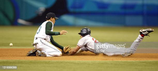 Tampa Bay Devil Ray shortshop Julio Lugo puts the tag without the ball on Boston Red Sox base runner Gabe Kapler during 8th inning at Tropicana Field...