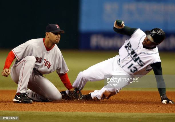Tampa Bay Devil Rays' Carl Crawford successfully steals second as Boston Red Sox' Alex Cora applies the tag late during Wednesday night's action at...