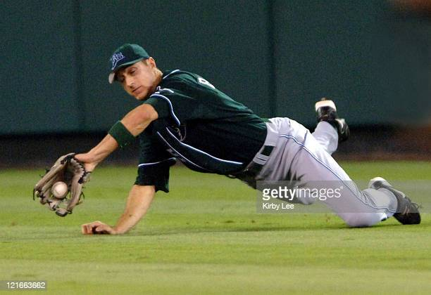 Tampa Bay Devil Rays center field Rocco Baldelli makes a diving catch in the sixth inning of 40 loss to the Los Angeles Angels of Anaheim at Angel...