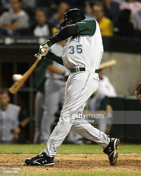 Tampa Bay Devil Rays center fielder Delmon Young singles during game action at U.S. Cellular Field, Chicago, Illinois on August 30, 2006. The White...