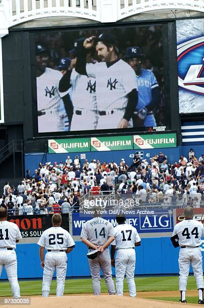 Tampa Bay Devil Rays' manager Lou Piniella joins former New York Yankees on the field to watch a video tribute to Thurman Munson during 58th annual...