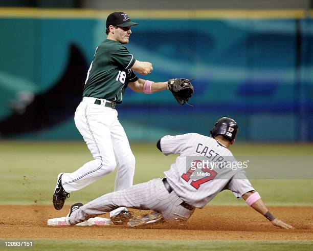 Tampa Bay Devil Rays second baseman Nick Green makes the throw onto first for the double play as Minnesota Twins infielder Juan Castro is out at...