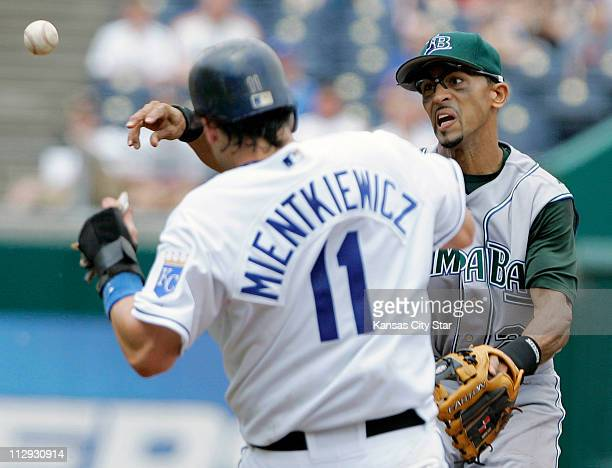 Tampa Bay Devil Rays shortstop Julio Lugo throws to first to complete the double play after forcing the Kansas City Royals' Doug Mientkiewicz out at...
