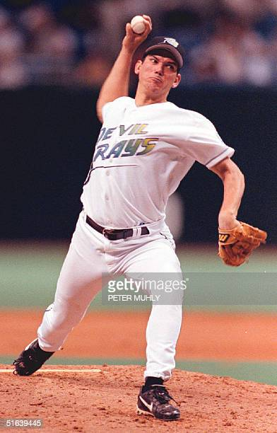 Tampa Bay Devil Rays' starting pitcher Rolando Arrojo throws a strike to Texas Rangers' Juan Gonzalez in the 3rd inning 01 June at the Tropicana...