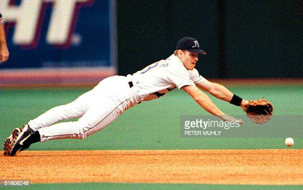 Tampa Bay Devils Ray Kevin Stocker dives, 25 April 1999, for Seattle Mariners' Edgar Martinez hit in the 1st inning at Tropicana Field in St....