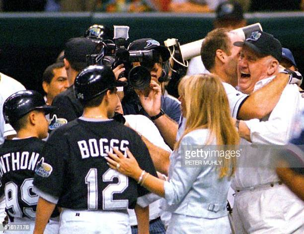 Tampa Bay Devils Ray Wade Boggs hugs his father after hitting a home run and his 3000th hit 07 August 1999 off of Cleveland Indians pitcher Charles...