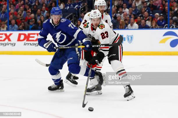 Tampa Bay Lightning center Anthony Cirelli battles Chicago Blackhawks defenseman Brandon Manning for the puck in the second period of the regular...