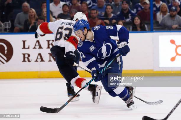 Tampa Bay Lightning center Brayden Point gets the puck around Florida Panthers right wing Evgenii Dadonov before scoring the game winning goal in the...