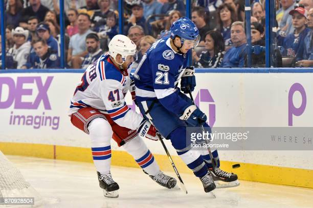 Tampa Bay Lightning center Brayden Point has the puck get between his skates as he tries to skate away from New York Rangers defender Steven Kampfer...