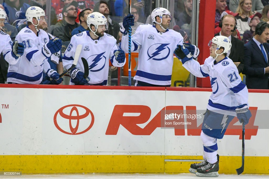 Tampa Bay Lightning center Brayden Point (21) is congratulated after scoring in the first period on February 20, 2018, at the Capital One Arena in Washington, D.C. The Tampa Bay Lightning defeated the Washington Capitals, 4-2.