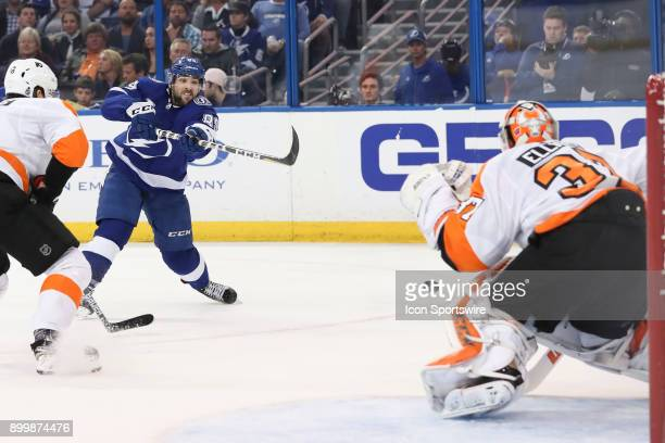 Tampa Bay Lightning center Cory Conacher takes a shot on Philadelphia Flyers goaltender Brian Elliott in the second period of the NHL game between...