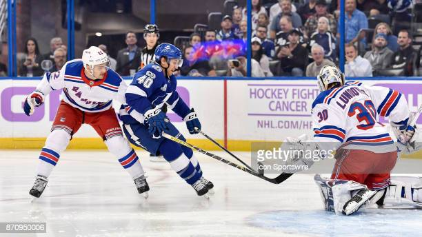 Tampa Bay Lightning center Gabriel Dumont drives the net while New York Rangers defender Kevin Shattenkirk defends during the first period of an NHL...