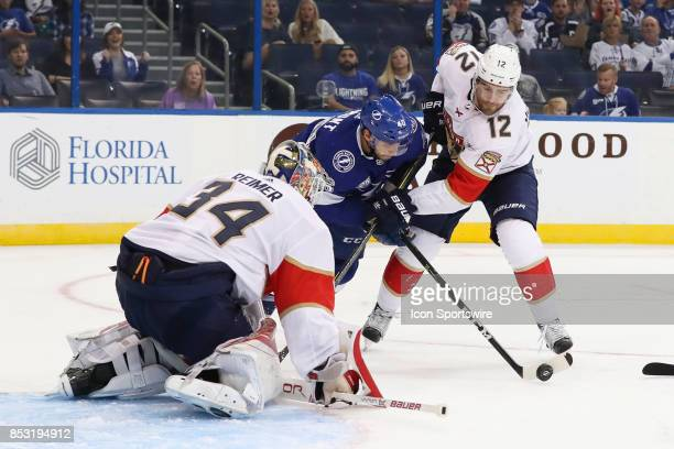 Tampa Bay Lightning center Gabriel Dumont is defended by Florida Panthers defenseman Ian McCoshen as he tries to get a shot on Florida Panthers...