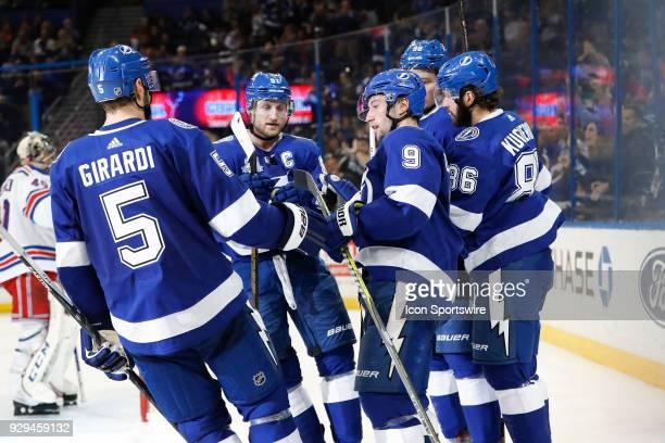 Tampa Bay Lightning center Tyler Johnson celebrates with teammates Dan Girardi Steven Stamkos Nikita Kucherov and Mikhail Sergachev after scoring a...