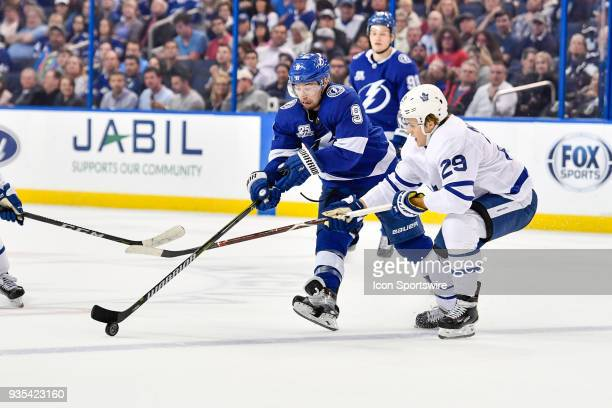 Tampa Bay Lightning center Tyler Johnson cuts inside on Toronto Maple Leafs center William Nylander during the second period of an NHL game between...