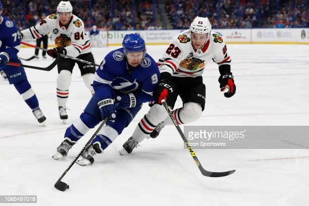 Tampa Bay Lightning center Tyler Johnson is defended by Chicago Blackhawks defenseman Brandon Manning in the second period of the regular season NHL...