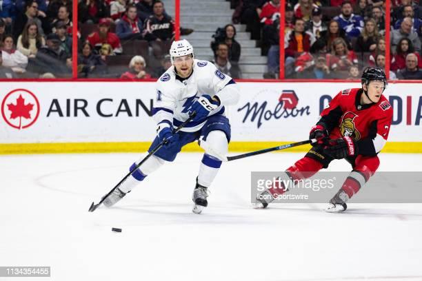 Tampa Bay Lightning Defenceman Erik Cernak passes the puck cross ice shadowed by Ottawa Senators Left Wing Brady Tkachuk during second period...