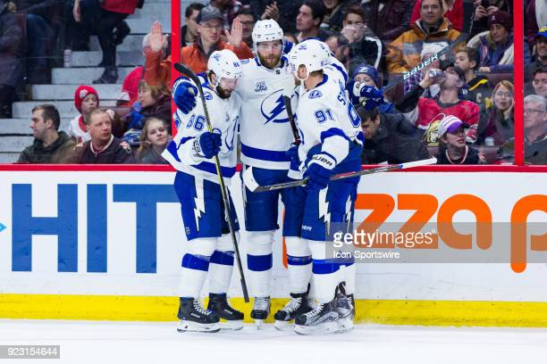 Tampa Bay Lightning Defenceman Victor Hedman is congratulated on his goal by teammates Right Wing Nikita Kucherov and Center Steven Stamkos during...