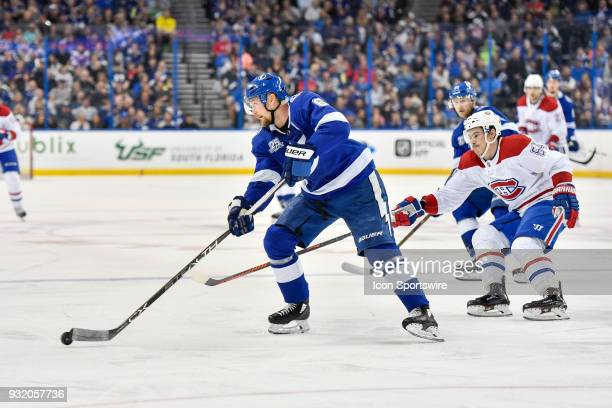 Tampa Bay Lightning defender Anton Stralman skates away from Montreal Canadiens left wing Charles Hudon during the third period of an NHL game...