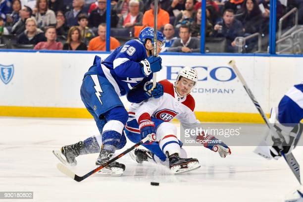 Tampa Bay Lightning defender Jake Dotchin checks Montreal Canadiens left wing Charles Hudon off balance during the third period of an NHL game...