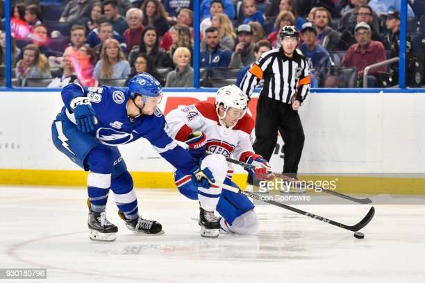 Tampa Bay Lightning defender Jake Dotchin poke checks Montreal Canadiens left wing Charles Hudon during the third period of an NHL game between the...