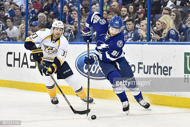 Tampa Bay Lightning defender Nikita Nesterov skates away from the backcheck of Nashville Predators left wing Colin Wilson during the first period of...