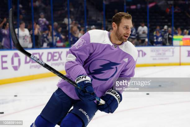 Tampa Bay Lightning defenseman Dan Girardi wears a Hockey Fights Cancer jersey before the regular season NHL game between the Edmonton Oilers and...