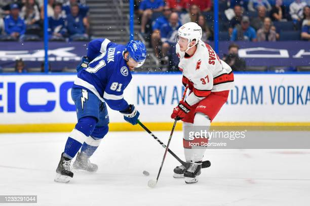 Tampa Bay Lightning defenseman Erik Cernak and Carolina Hurricanes right wing Andrei Svechnikov battle for a puck during Game 4 of the NHL Stanley...