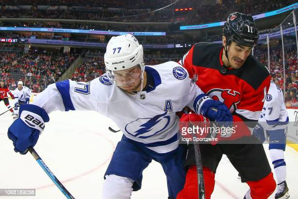 Tampa Bay Lightning defenseman Victor Hedman battles New Jersey Devils center Brian Boyle during the National Hockey League game between the New...