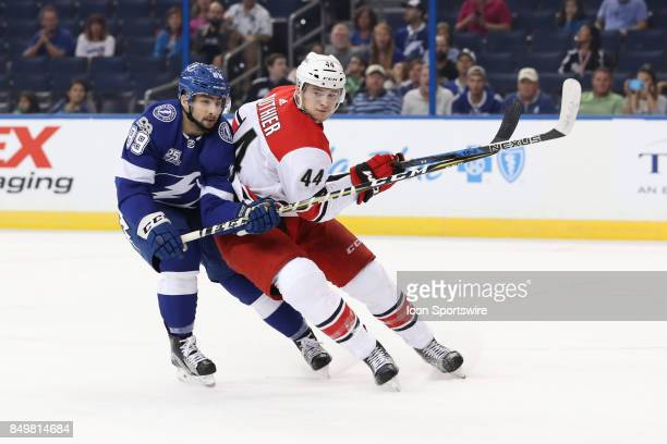Tampa Bay Lightning forward Cory Conacher and Carolina Hurricanes forward Julien Gauthier in action in the 1st period of the NHL preseason game...