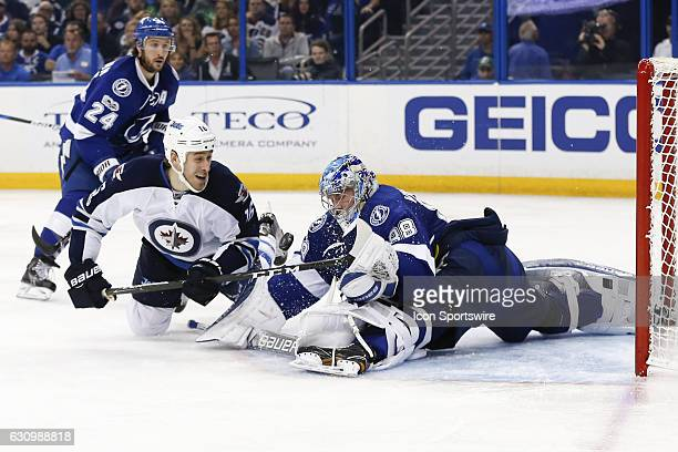 Tampa Bay Lightning goalie Andrei Vasilevskiy makes a diving save on a shot from Winnipeg Jets center Shawn Matthias on in the third period of the...
