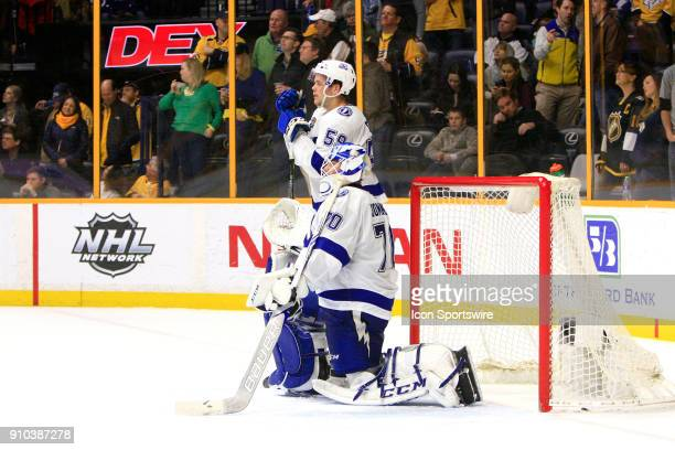 Tampa Bay Lightning goalie Louis Domingue and Tampa Bay Lightning defenseman Jake Dotchin wait as referees review a second period goal by Nashville...