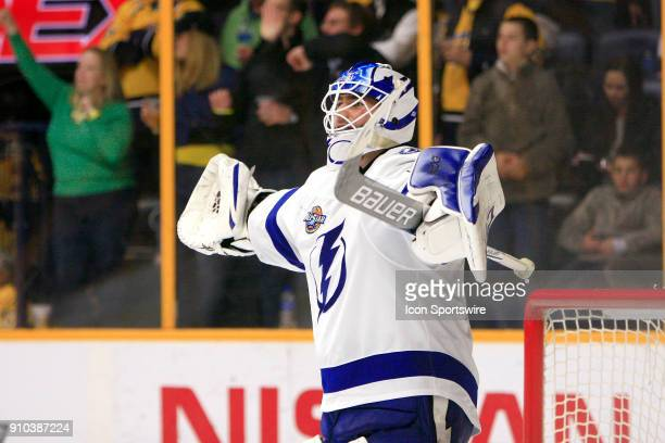 Tampa Bay Lightning goalie Louis Domingue reacts after a goal by Nashville Predators defenseman PK Subban during the second period of the NHL game...