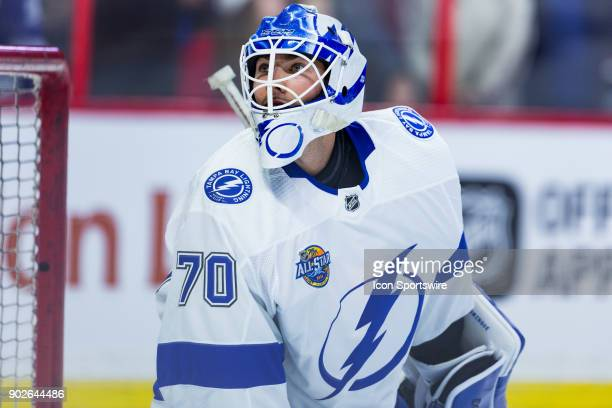 Tampa Bay Lightning Goalie Louis Domingue watches a puck go wide of the net during warmup before National Hockey League action between the Tampa Bay...