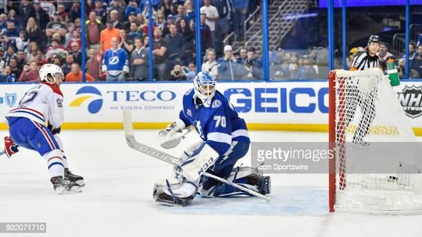 Tampa Bay Lightning goalie Louis Domingue watches the shootout goal go into the net as Montreal Canadiens center Jonathan Drouin skates off during...