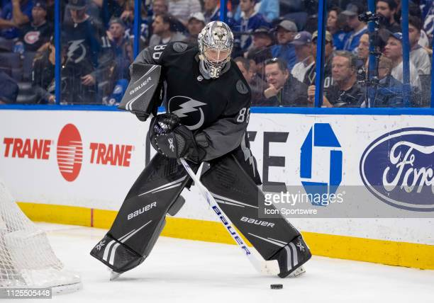 Tampa Bay Lightning goaltender Andrei Vasilevskiy clears the puck from behind the net during the NHL Hockey match between the Lightning and Canadiens...