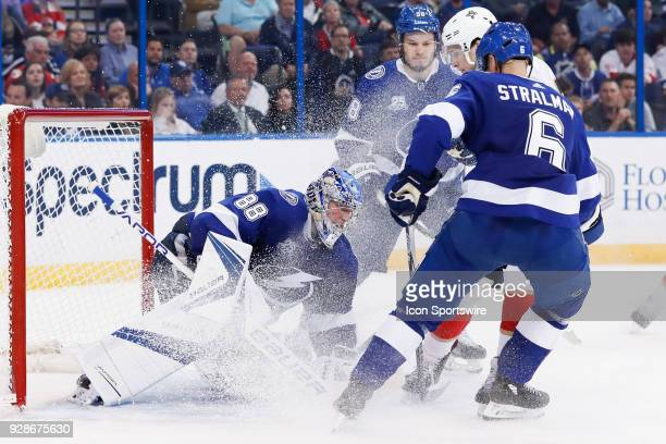 Tampa Bay Lightning goaltender Andrei Vasilevskiy covers the puck as hes covered in snow from Tampa Bay Lightning defenseman Anton Stralman Florida...