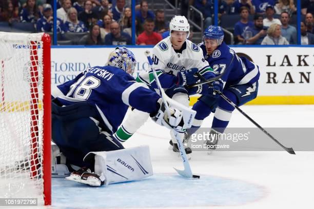 Tampa Bay Lightning goaltender Andrei Vasilevskiy makes a stick save on a shot from Vancouver Canucks center Elias Pettersson during the regular...