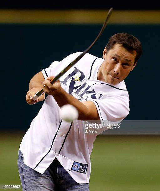 Tampa Bay Lightning head coach Guy Boucher shoots the first pitch just before the start of the game between the Tampa Bay Rays and the Toronto Blue...
