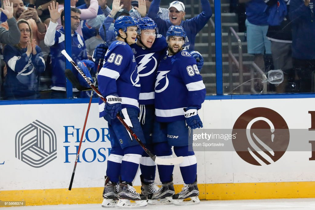 Tampa Bay Lightning left wing Adam Erne (73) celebrates with Tampa Bay Lightning center Vladislav Namestnikov (90) and Tampa Bay Lightning center Cory Conacher (89) after scoring a goal in the second period of the NHL game between the Vancouver Canucks and Tampa Bay Lightning on February 08, 2018 at Amalie Arena in Tampa, FL.