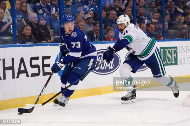 Tampa Bay Lightning left wing Adam Erne is defended by Vancouver Canucks defenseman Erik Gudbranson in the second period of the NHL game between the...