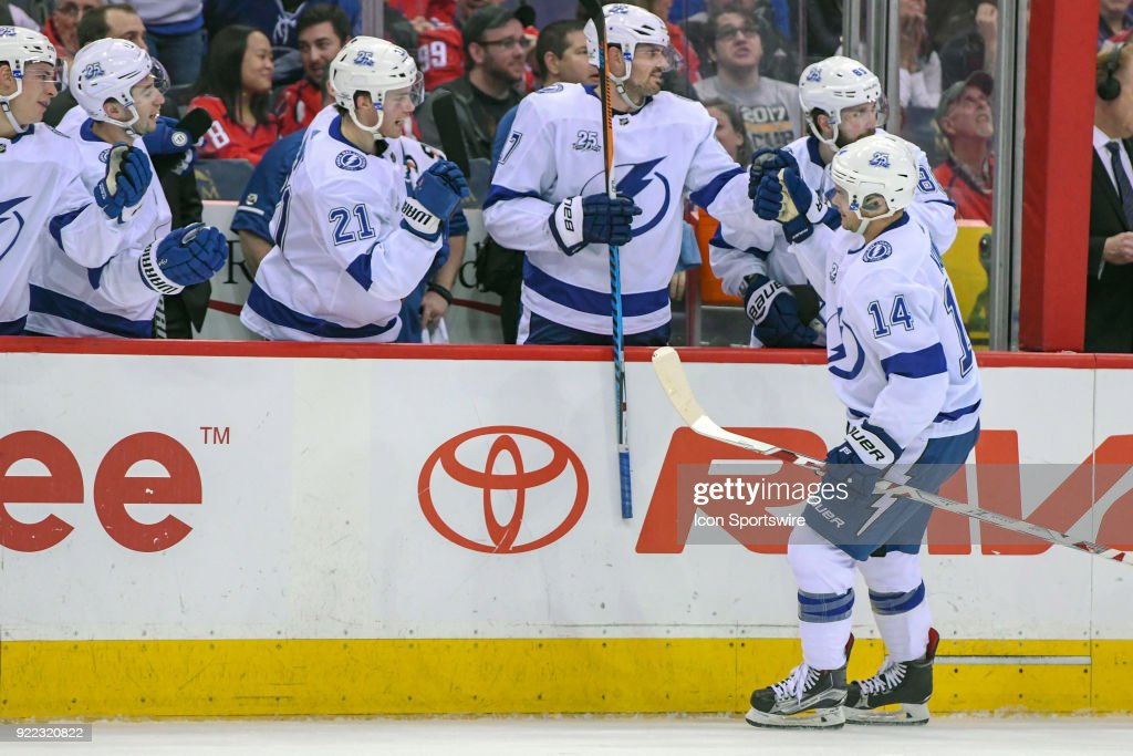 Tampa Bay Lightning left wing Chris Kunitz (14) is congratulated after scoring in the first period on February 20, 2018, at the Capital One Arena in Washington, D.C. The Tampa Bay Lightning defeated the Washington Capitals, 4-2.