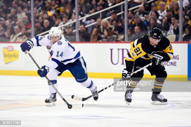 Tampa Bay Lightning Left Wing Chris Kunitz moves the puck ahead of Pittsburgh Penguins Right Wing Phil Kessel during the third period in the NHL game...