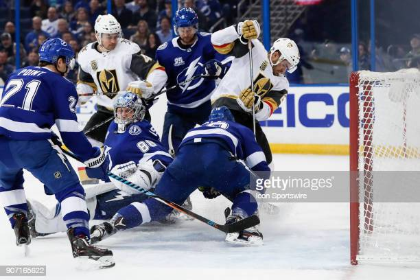 Tampa Bay Lightning left wing Ondrej Palat dives across the net to keep Vegas Golden Knights left wing William Carrier from scoring after the puck...