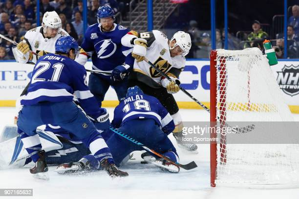 Tampa Bay Lightning left wing Ondrej Palat dives across the net to keep Vegas Golden Knights left wing William Carrier from scoring in the first...
