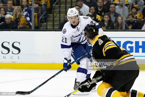 Tampa Bay Lightning right wing Brayden Point lines up a shot watched by Boston Bruins right defenseman Colin Miller during a regular season NHL game...